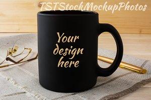 Black mug mockup with glasses