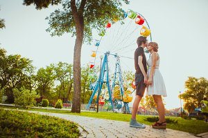 guy and the girl hugging at amusement background