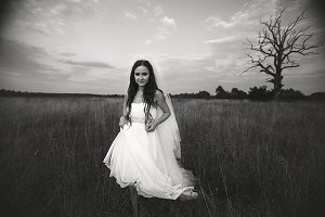 Bride crosses the autumn field
