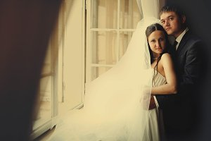 Bride and groom look thoughtful