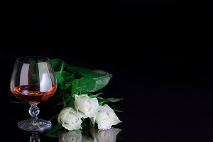 Glass and rose. Alcohol and flower.