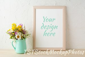 Frame mockup with mint green vase