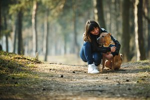 young girl with Shar Pei dog