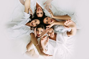 Positive bridesmaids and a bride