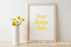Frame mockup with yellow chamomiles