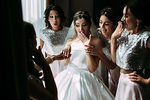 Amazed bride and her glamorous girls