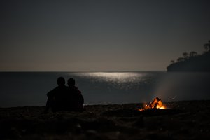 Couple on a night beach