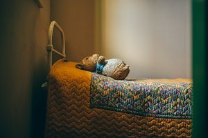 A photo of a vintage bed and toy