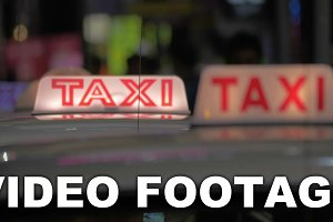 Taxi cars on night road