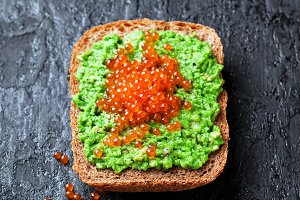 Avocado and red caviar sandwich
