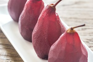 Merlot-poached pears on the plate