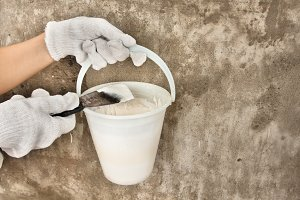 bucket with plaster and spatula