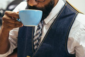 Afro American man drinking coffee
