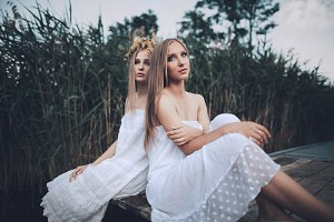 two blonde girls summer portrait