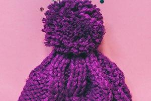 Purple warm hat. Vertical