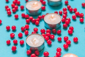 Candles and berries. Vertical