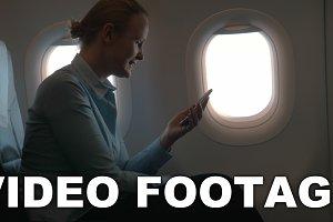 In cabin of plane girl sitting