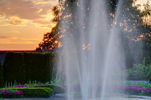 Water fountain with sunset at a park