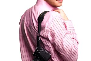 man in pink shirt with camera