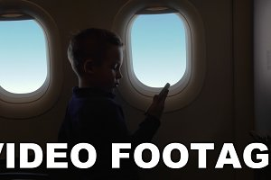 In cabin of plane little boy