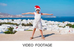 Funny girl in red Santa hat
