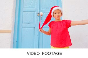 Girl in red hat outdoors on Mykonos