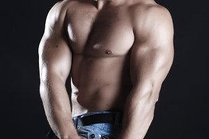 Young man athlete with perfect body