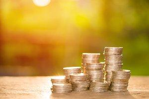 Money pile coins on sunlight