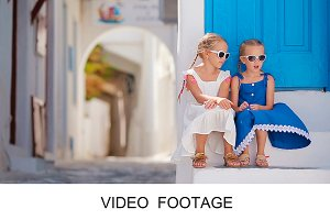 Kids in blue dresses Mykonos street