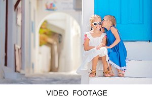 Cute little girls on Mykonos Island