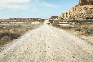 Tourist car and vintage dirt road