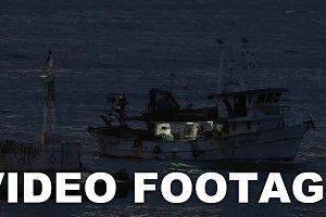 Schooner sailing in sea at night
