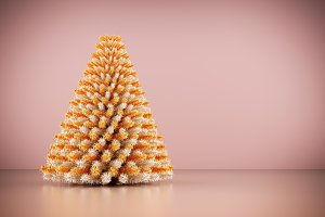 Shining modern Christmas tree on rose gold wall background.