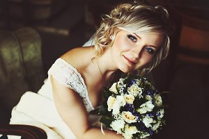Pretty blonde bride smiles