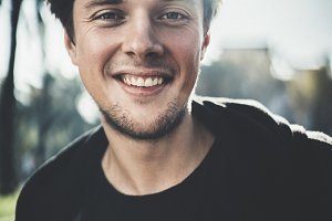Close-up portrait of smiling guy
