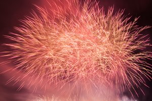 Spectacular fireworks show light up the sky. New year celebration.