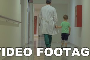 Child and doctor walking