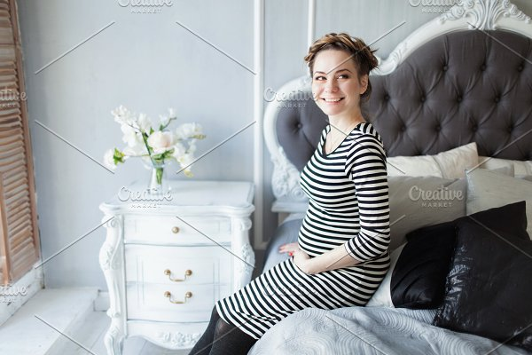 Young beautiful pregnant woman with husky stock photo