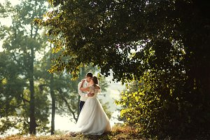The brides embracing in the park