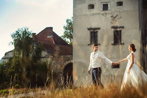 Couple in love walking near castle