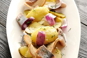 Fried potato and pickled herring
