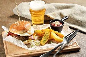 Burger, mexican potatoes and ketchup