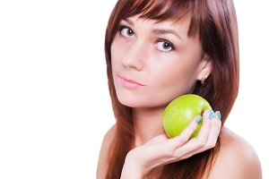 Young woman holding green apple - face close