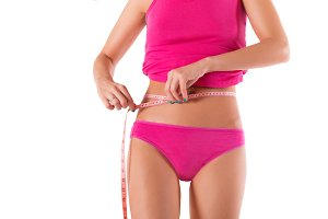 Slim woman body with measure tape