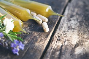 natural medicine products on wooden background