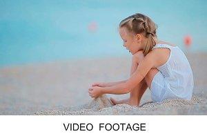 Adorable girl at tropical beach