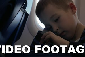 In plane sits a little boy