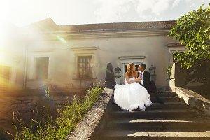 Sun shines under a wedding couple