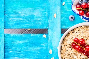 Blue background with oats and berry