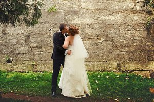 Groom kisses a bride
